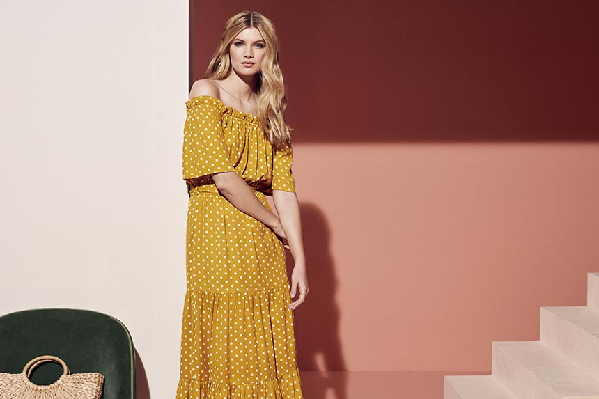 A mustard colored Bardot dress with white polka dots. Can you resist this? Image by Dorothy Perkins.