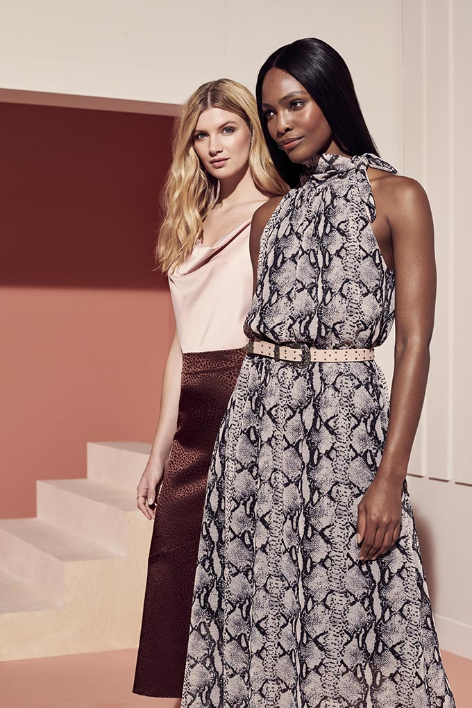 Both outfits on both women are great but I like the snake print dress best paired with a thin blush pink belt around the waist. Image by Dorothy Perkins.