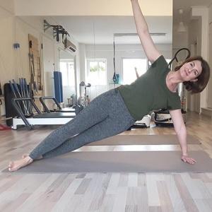 Ifiyenia in a Pilates position.