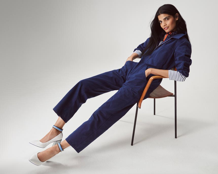 A denim jumpsuit with a striped top underneath and white pumps is looking awfully good. Image by Marks and Spencer.