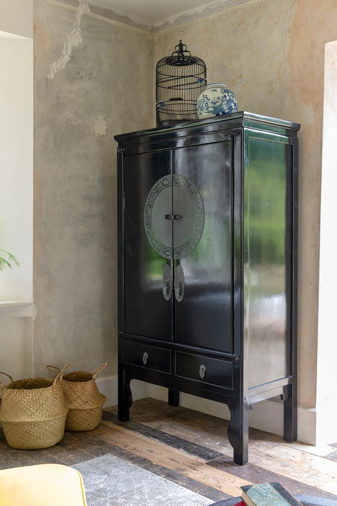 A vignette with a black Chinese wedding cabinet that I think can make a great add on in an mix and match home interior. Image by Orchid Furniture.