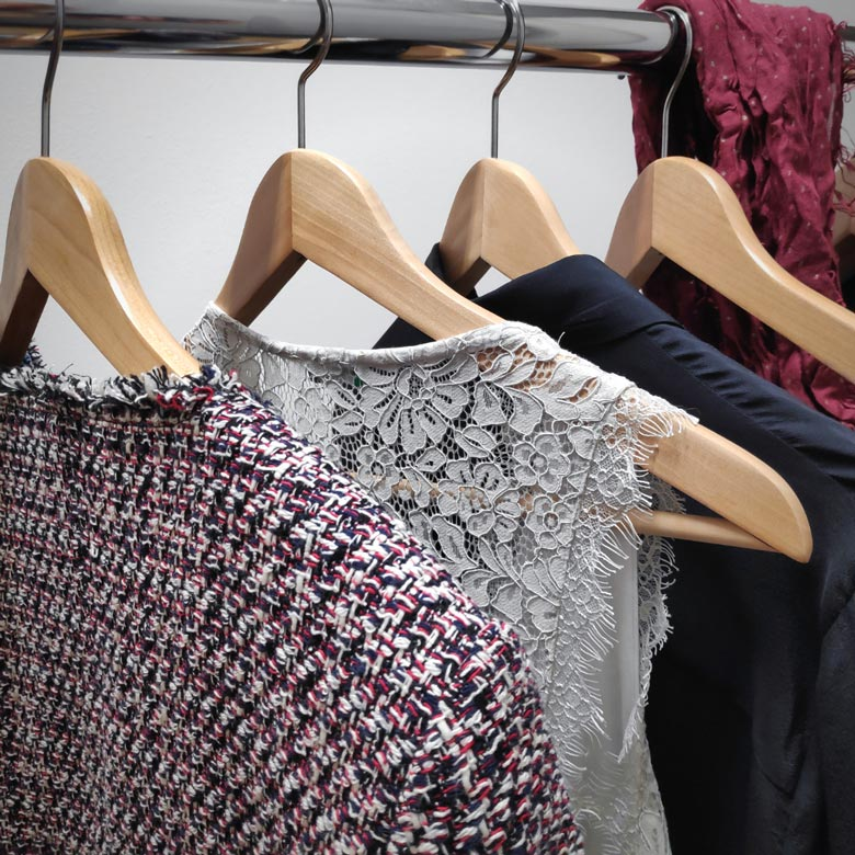 Close view of clothes hanging. Image by Velvet.
