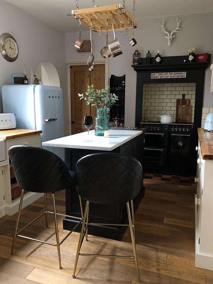 A touch of black in a kitchen goes a long way. The stove, the island and those beautiful bar stools create a catching center axis across this kitchen turning up its sophistication level. I love the Heather barstools with a sense of art deco because of the touch of glamour. Image by Cult Furniture.