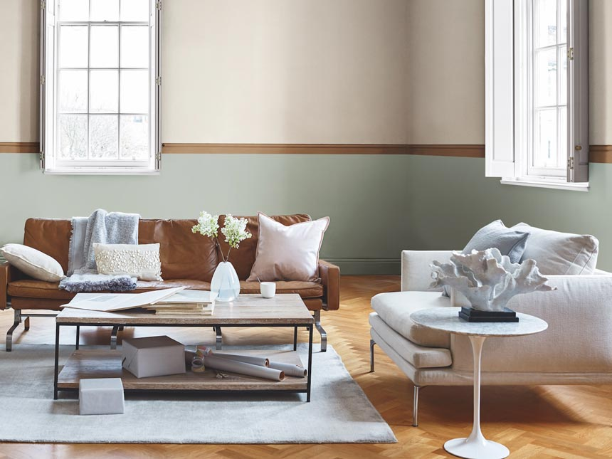 A bright, contemporary living room with caramel accents and neutral tones. Image by Dulux.