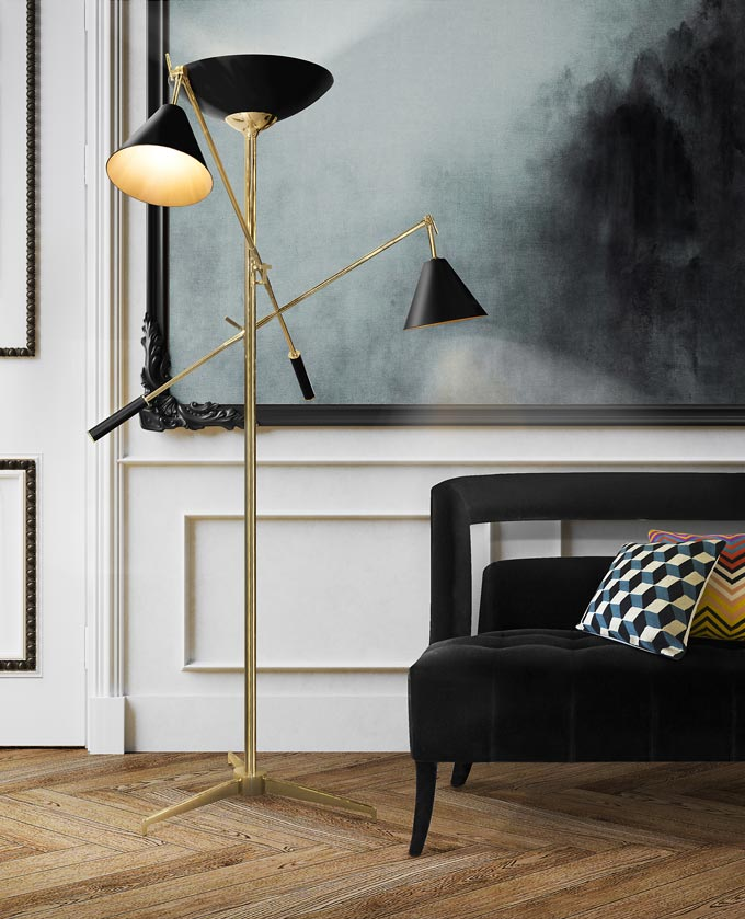 The Torchiere, a floor lamp with so many add on arms with a golden and black finish makes perfect for uplighting, downlighting and reading lighting. In this image it stands out against an art image. Image by DelightFULL.