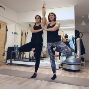 Ifiyenia and Tina while doing a Yogilates exercise.