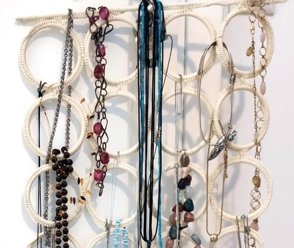 An IKEA scarf hanger used for hanging faux jewelery.