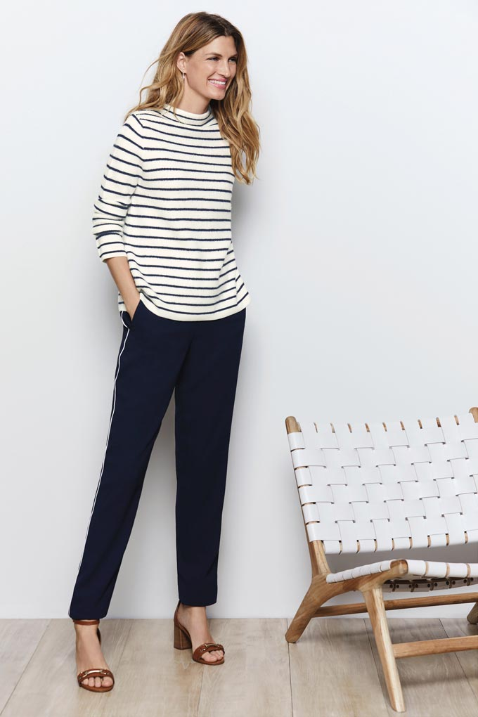 A Breton top with a loose fit over slim black pants and high heel sandals is a timeless outfit. Image by Pure Collection.