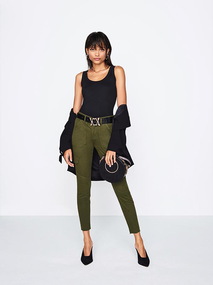 An almost all black outfit except of those slim khaki pants that act as an accent piece. It will surely make some heads turn. Image by River Island.
