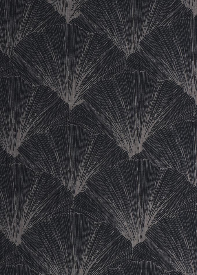 A fan like print on a black background of a wallpaper. Image by Rug'Society.