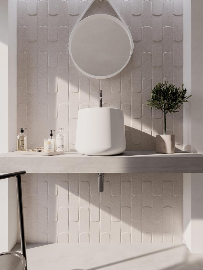 What a beautiful bathroom with a very super soft off pink wall tile, round mirror and white washbasin. Image by WOW Design.