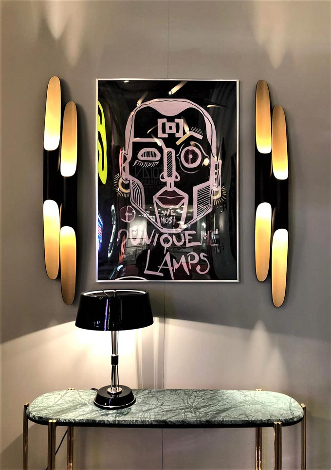 An eclectic vignette with beautiful wall lights, art image and table as seen at iSaloni 2019 in Milan from DelightFULL.