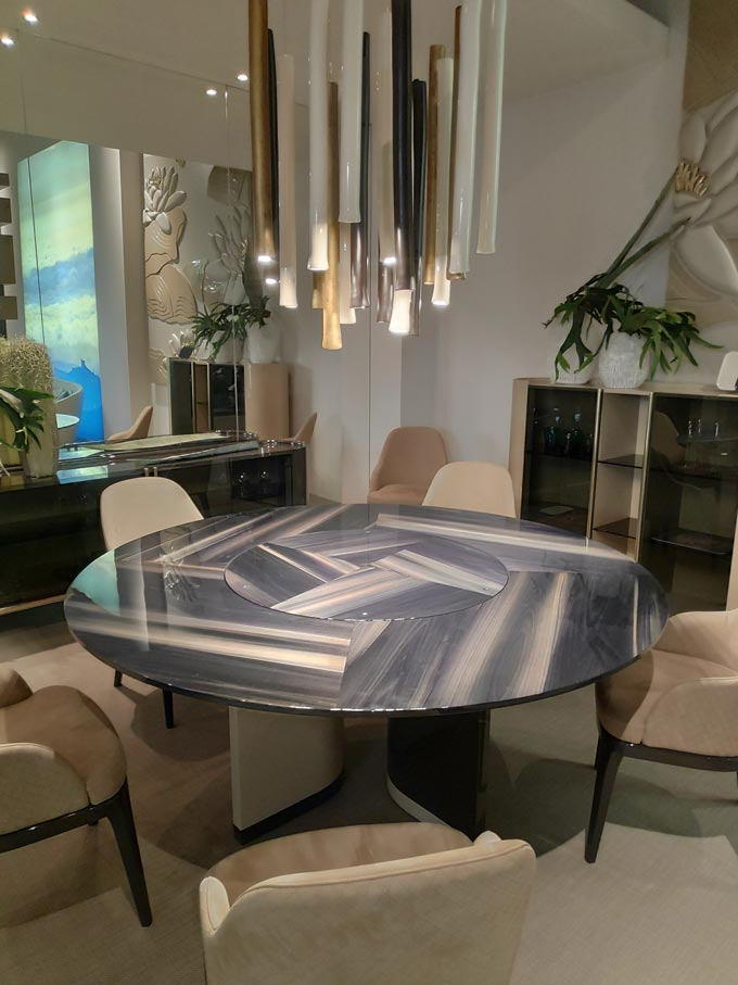A luxurious dining setting with a black marble top dining table at iSaloni 2019 in Milan.
