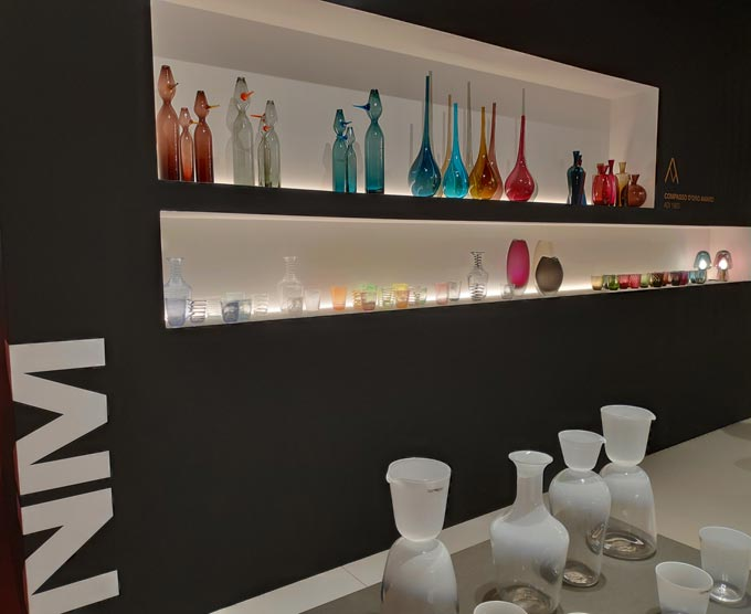 Display of colored Murano glassware at iSaloni 2019 in Milan.