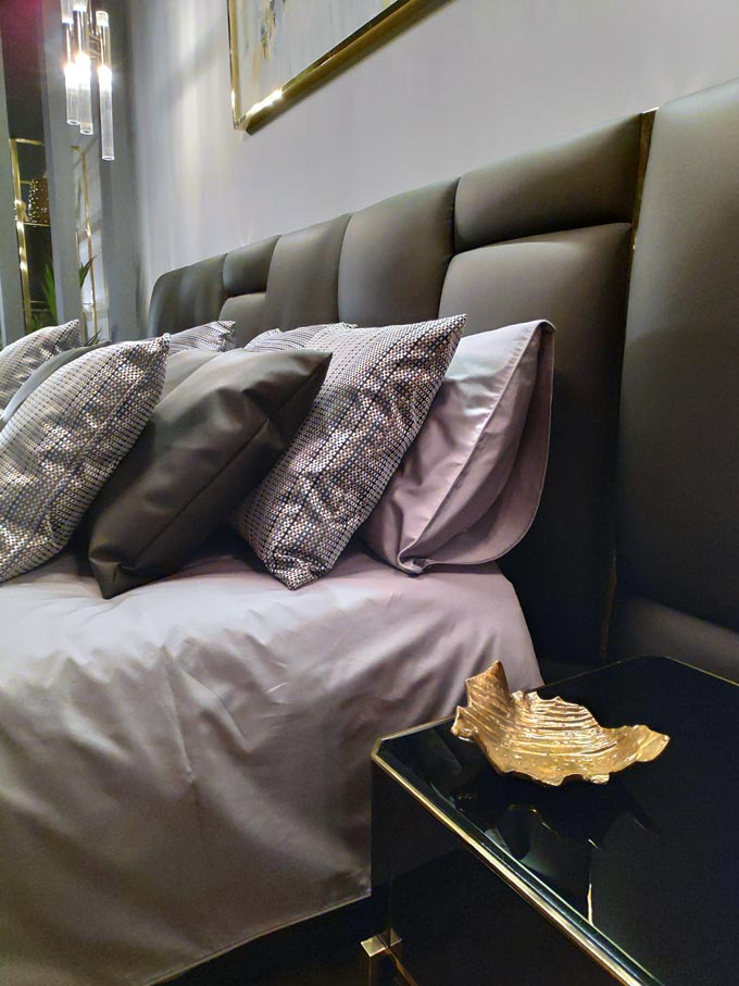 Detail of a bed with a night table by LUXXU at iSaloni2019 in Milan.
