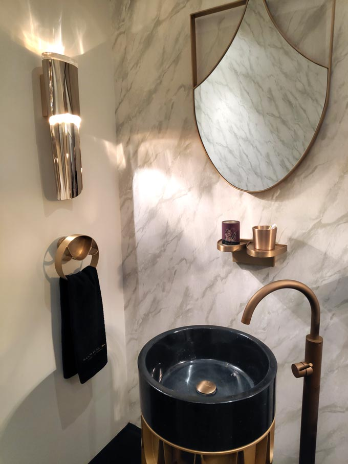 A luxurious bathroom installation with brassy taps and accessories from Maison Valentina at iSaloni2019 in Milan.