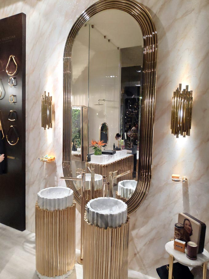 A luxurious bathroom with two round washbasins from Maison Valentina at iSaloni 2019 in Milan.