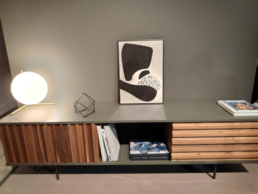 A beautiful sideboard with wooden slat doors by [More] at iSaloni 2019 in Milan.