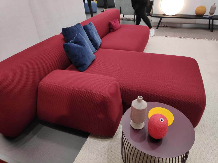A red modular corner sofa with a side table from iSaloni2019 in Milan.