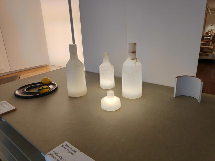 Frosted white bottles and a tray, all products by Spanish designers on display during Milan's Design Week.