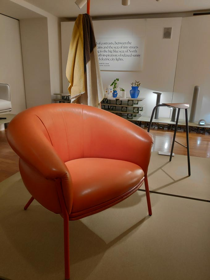 A rusty toned leather armchair by a Spanish designer during Milan's Design Week.