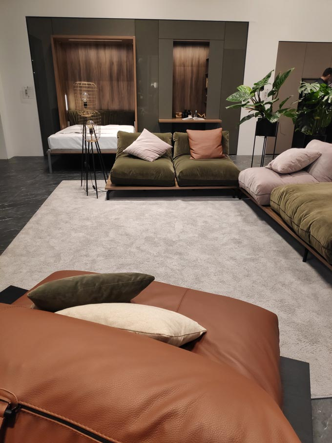 A beautiful space with multi-functional furniture from Tumidei at iSaloni 2019 in Milan in organic hues like deep olive green and rusty tones.