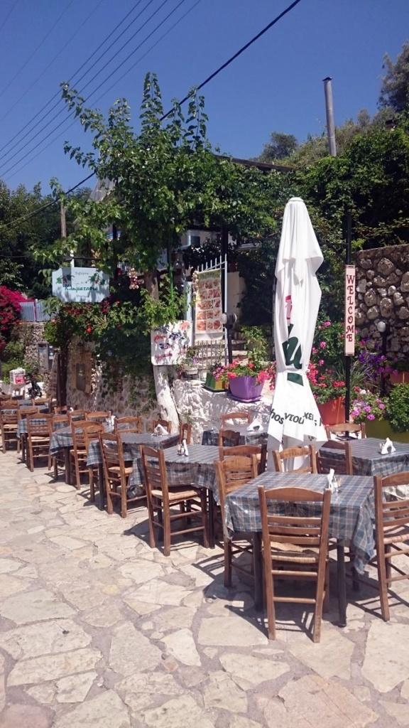 A traditional outdoor taverna setup at the seaside village of Agios Nikitas in Lefkada. Image by Velvet Karatzas.