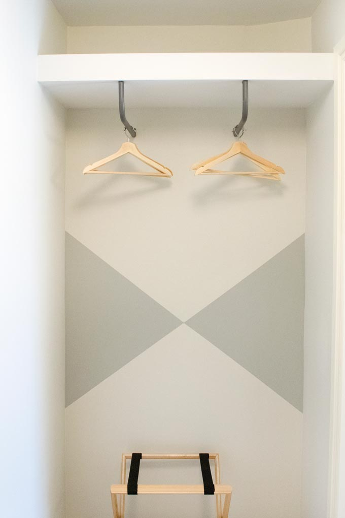 "Detail view of an ""open"" wardrobe designed by Velvet Karatzas with color blocking from a renovation project."