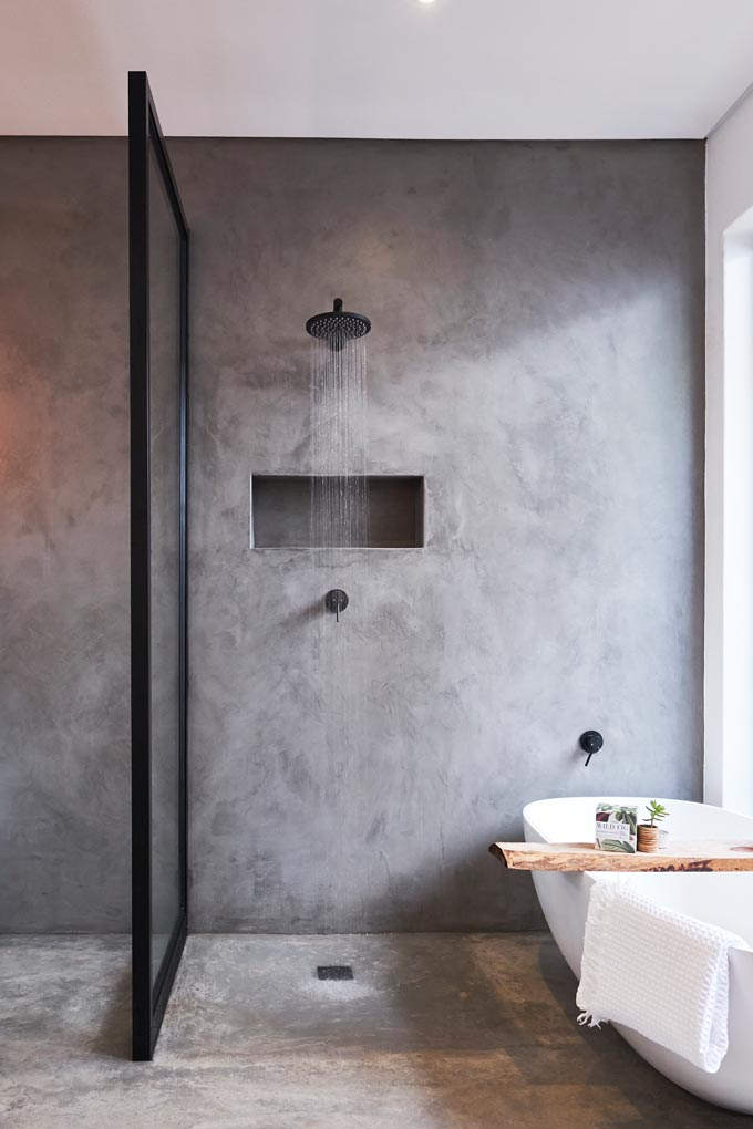 A gorgeous grey walk in shower with black fittings. Image by Meir Australia Pty Ltd