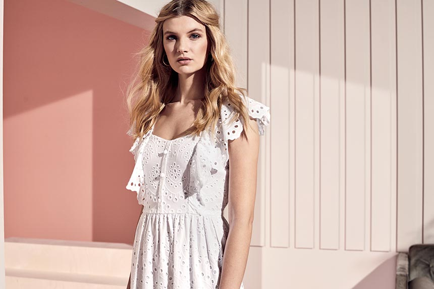 A white dress with lace details and ruffles. Image by Dorothy Perkins.