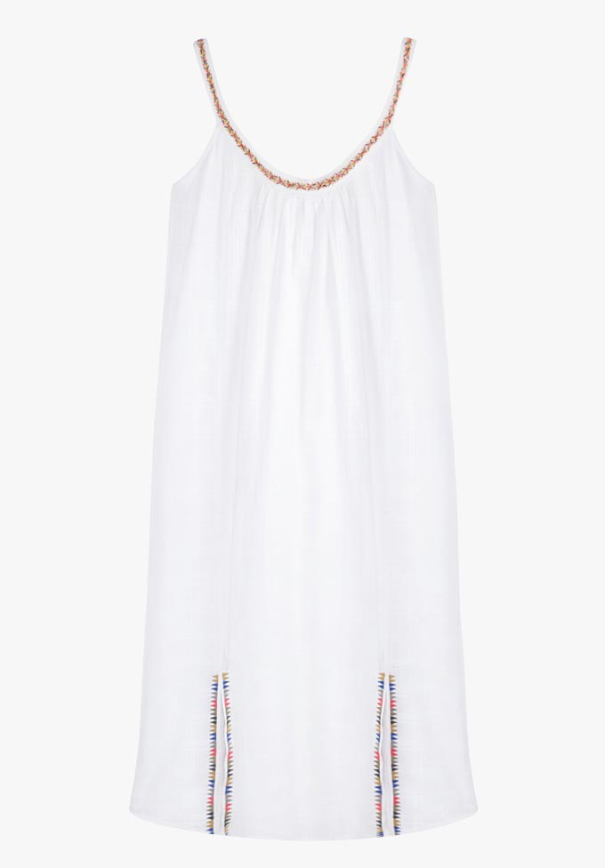 A short white dress with two cutouts by Hush.