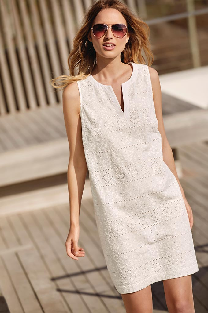A white linen shift dress looking good. Image by M&Co.