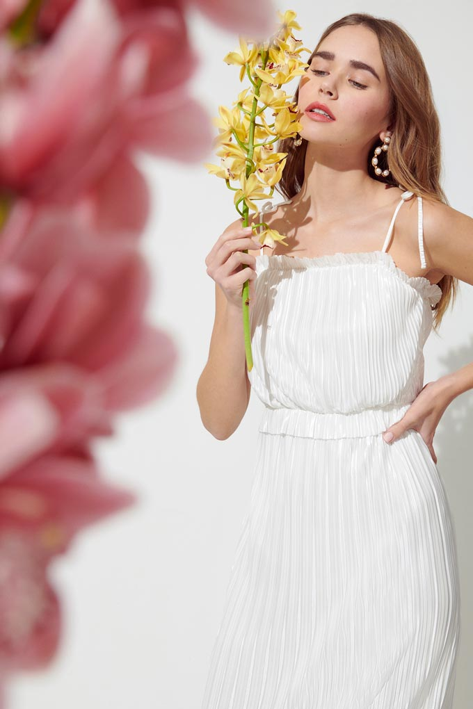 A beautiful white dress with soft pleats and spaghetti straps. Image by Miss Selfridge.