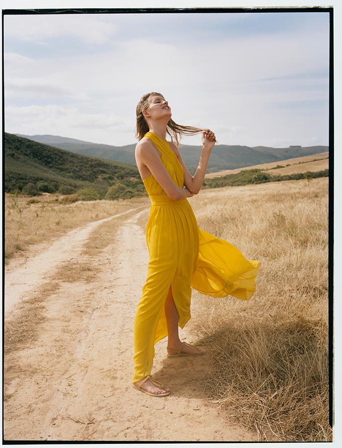 A maxi yellow summer dress like this is bound to make heads turn and looks amazing with when paired with flat sandals like these ones. Image by Monsoon.