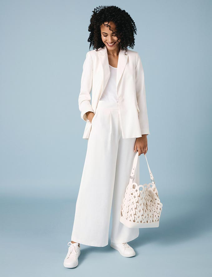 The all white outfit: blazer, top, wide leg pants, tote bag, trainers. Perfection! Image by Oasis.