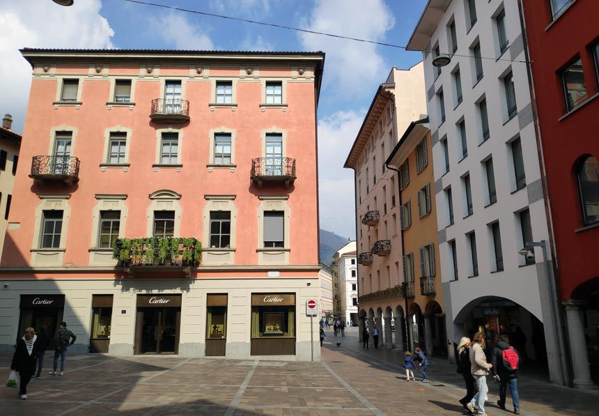Colorful buildings within a pedestrian zone in the old town of Lugano.