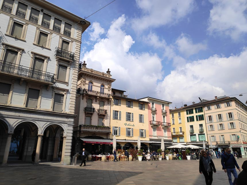 One of the squares with lots of old buildings in the old town of Lugano.