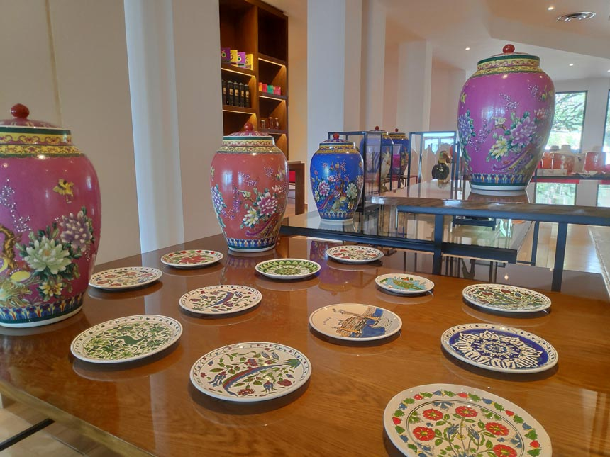 View of different styled ceramic pottery on display at Grecotel Lux Me Rhodos lobby.