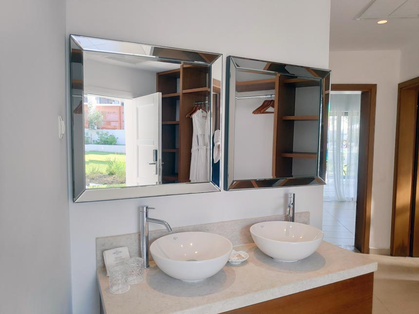 The vanity with a double mirror and double sink as found in a corridor between the newly renovated bungalow of Grecotel Lux Me Rhodos.