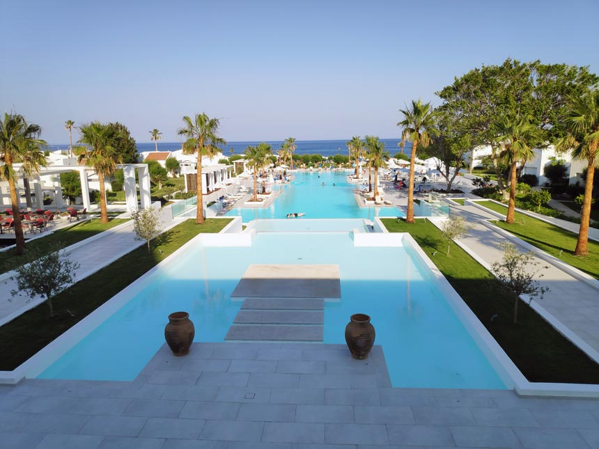 View of the large swimming pool of Grecotel Lux Me Rhodos.