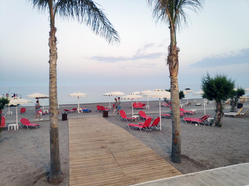 Partial view of the sandy beach in front of Grecotel Lux Me Rhodos.