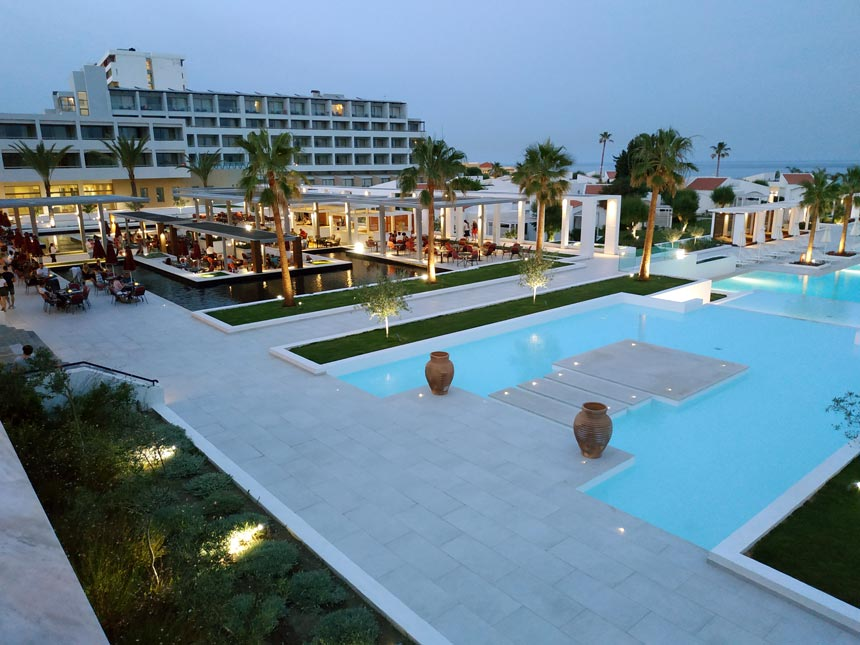 Partial view of the large pool and outdoor dining spaces of Grecotel Lux Me Rhodos.