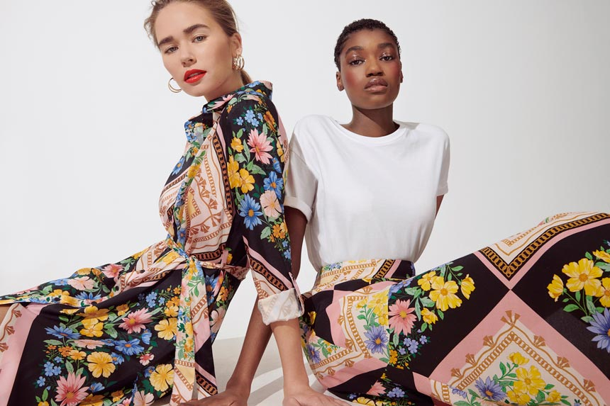 Love the boldness of this print pattern. Two women wearing a bold print dress and a white top with the same print maxi skirt. Image by Miss Selfridge.