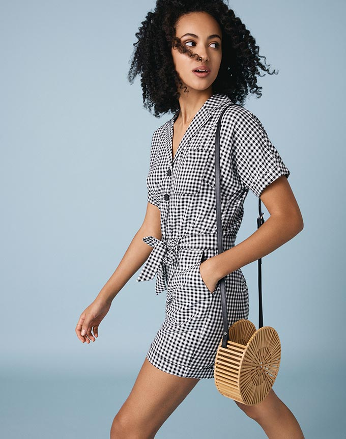 A gingham pattern playsuit like this will not go un-noticed! Image by Oasis.
