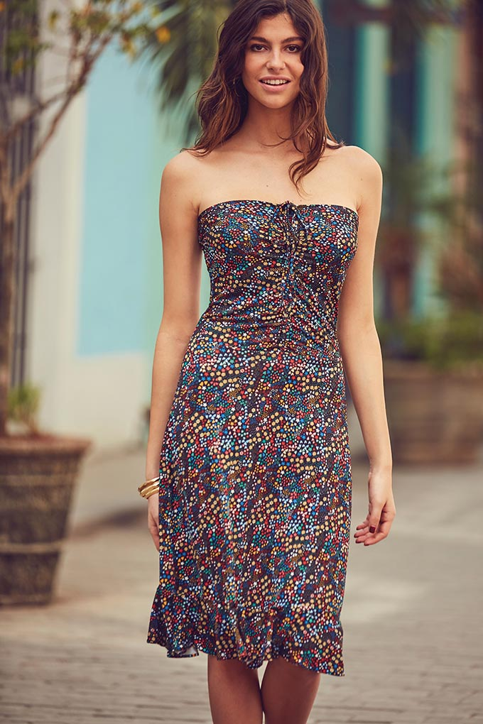A bandeau summer dress with countless different colored polka dots giving you the impression of beads. Out of the ordinary, yet stylish. Image by Sosandar.