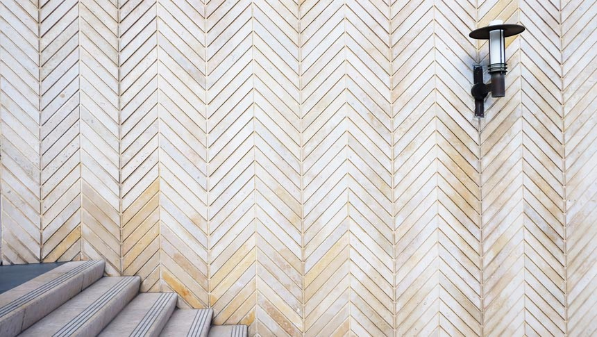 A chevron pattern tiled wall.