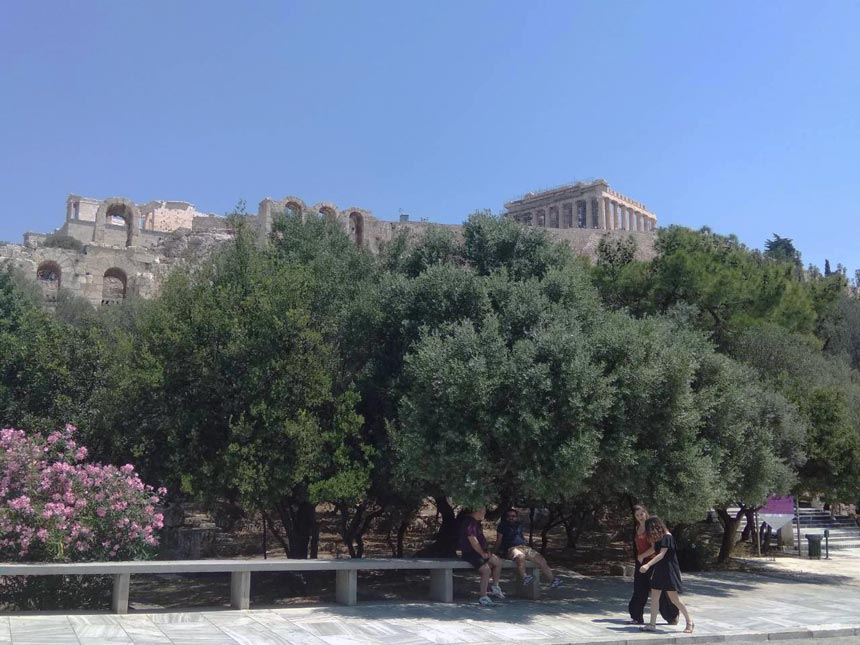 Two women walking up Areopagitou street in Athens. In the background the Acropolis can be discerned.
