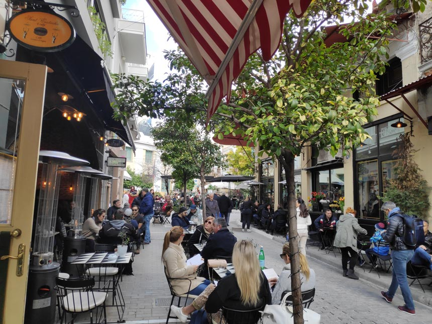 People having coffee, a popular pastime in Athens, outdoors downtown Athens, Greece.