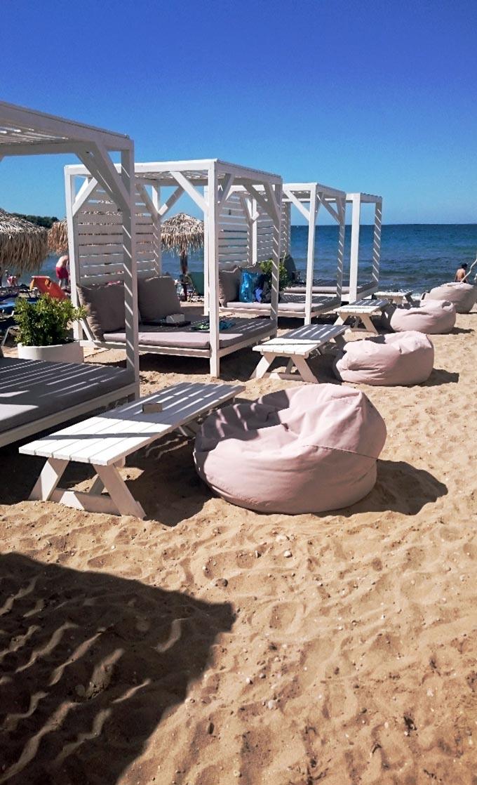 Gazebos at a sandy beach along the Athenian coastline.