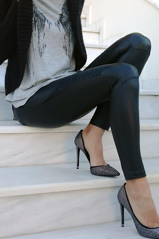Velvet wearing a grey top over black faux leather leggings and paired with Rachel Zoe heels.